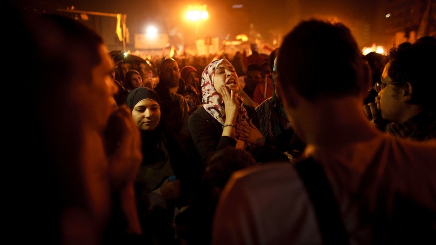 In this Friday, Jan. 25, 2013 photo, an Egyptian woman chants slogans in Tahrir Square in Cairo, Egypt, two years after the uprising that ousted President Hosni Mubarak. Egyptian women are growing increasingly angry and militant as they deal with one of the unintended consequences of the uprising _ an epidemic of sexual assault. The angry backlash, which includes self-defense courses and even threats of violent retaliation, is fueled by ultraconservative Islamists who suggest women invite assault by attending anti-government protests where they mix with men. (AP Photo/Maya Alleruzzo)