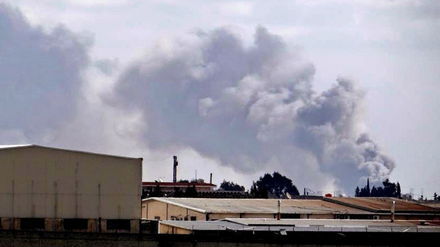 Citizen journalism image provided by Aleppo Media Center AMC which has been authenticated based on its contents and other AP reporting, shows smoke rises from Aleppo International Airport, Syria, Tuesday Feb. 12, 2013. Rebels captured a military air base in northern Syria on Tuesday, handing opposition fighters their second strategic victory in their nearly two-year battle against President Bashar Assad in as many days, activists said. (AP Photo/Aleppo Media Center AMC)