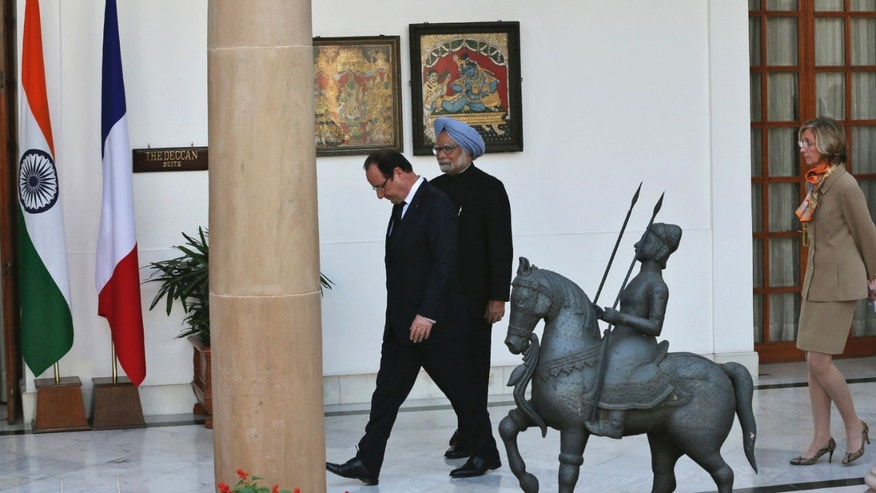 French President Francois Hollande, left, arrives with Indian Prime Minister Manmohan Singh, for delegation level talks in New Delhi, India, Thursday, Feb. 14, 2013. Hollande is on a two-day visit to India. (AP Photo/Manish Swarup)