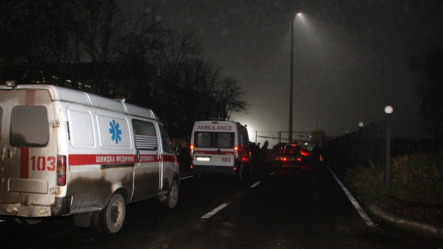 Emergency vehicles arrive at Donetsk airport, Wednesday Feb. 13, 2013, after a plane crash-landed at the airport. A small passenger plane skidded past the landing strip and overturned in the eastern Ukrainian city of Donetsk on Wednesday, killing five people. (AP Photo/Irina Gorbaseva)