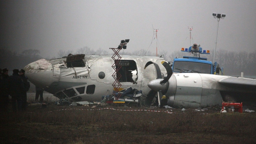 Ukrainian AN-24 plane is seen after crash outside an airport  in the eastern Ukrainian city of Donetsk, Thursday, Feb. 14, 2013. A passenger plane carrying soccer fans headed for a match between Ukraine's Shakhtar and Borussia Dortmund, skidded past the landing strip and overturned on Wednesday, killing five people. The plane was carrying 44 people from the Black Sea port of Odessa. (AP Photo/Irina Gorbaseva)
