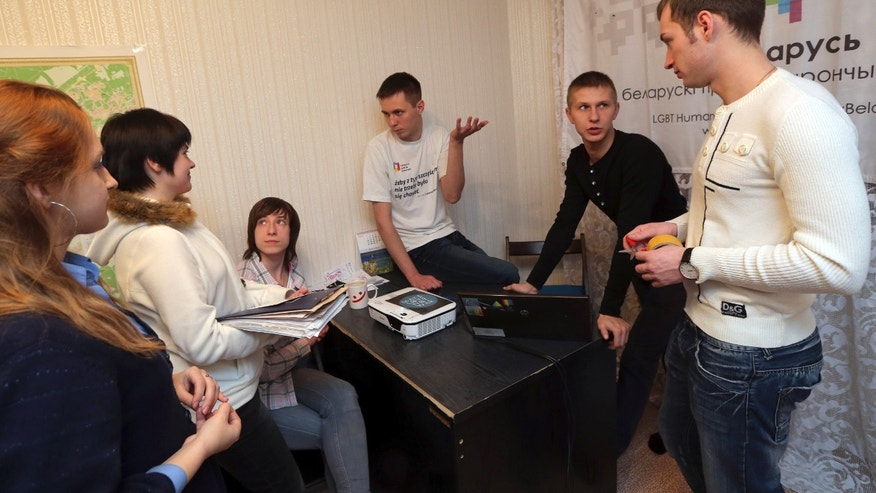 In this photo taken on Friday, Jan. 25, 2013, Siarhei Androsenka, center back, 24-year-old leader of GayBelarus, meets with his friends at home in Minsk, Belarus. Gay activists across Belarus emerged from the shadows and tried to register their rights organizations, but their efforts to go legal have been met by a wave of repressions. (AP Photo/Sergei Grits)