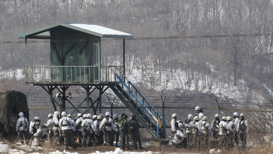 South Korean army soldiers gather as they attend an exercise near the demilitarized zone of Panmunjom in Paju, South Korea, Thursday, Feb. 14, 2013. North Korea's neighbors bolstered their military preparations and mobilized scientists Wednesday to determine whether Pyongyang's third nuclear test, conducted in defiance of U.N. warnings, was as successful as the North claimed.(AP Photo/Ahn Young-joon)