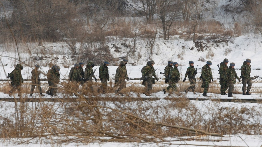 South Korean army soldiers march during an exercise near the demilitarized zone of Panmunjom in Paju, South Korea, Thursday, Feb. 14, 2013. North Korea's neighbors bolstered their military preparations and mobilized scientists Wednesday to determine whether Pyongyang's third nuclear test, conducted in defiance of U.N. warnings, was as successful as the North claimed.(AP Photo/Ahn Young-joon)