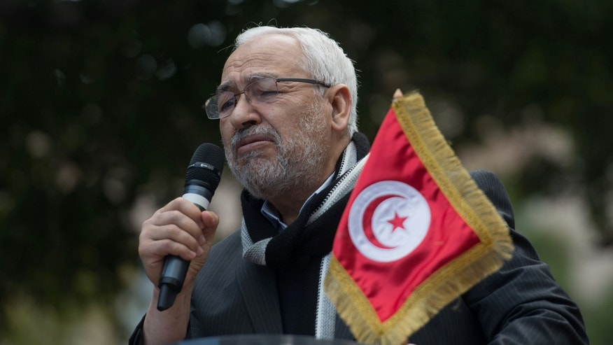 Leader of the Islamist ruling party Ennahda, Rached El Ghannouchi, speaks to supporters during a meeting in Tunis, Tunisia, Saturday, Feb. 16, 2013. Activists from Tunisia's ruling Islamist party Ennahda denounce in a protest the plans for a government of technocrats  to solve the country's crisis. (AP Photo/Amine Landouls)