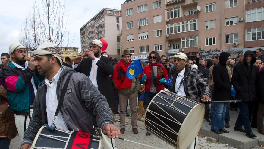Kosovo Albanian musicians play on the streets of Pristina celebrating the 5th anniversary since Kosovo seceded from Serbia on Sunday, Feb. 17, 2013. Serbia rejects Kosovo's independence. (AP Photo/Visar Kryeziu)