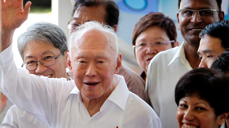 FILE - In this April 27, 2011 file photo, Singapore's Minister Mentor Lee Kuan Yew waves to supporters as he arrives at an elections nomination center in Singapore.   A statement from the Prime Minister's Office says the 89-year-old Lee was admitted to Singapore General Hospital on Friday, FEB. 15, 2013,  after experiencing a suspected transient ischaemic attack, which occurs when blood flow to the brain stops for a period of time. The condition is associated with irregular heartbeats.  (AP Photo/Wong Maye-E, File)