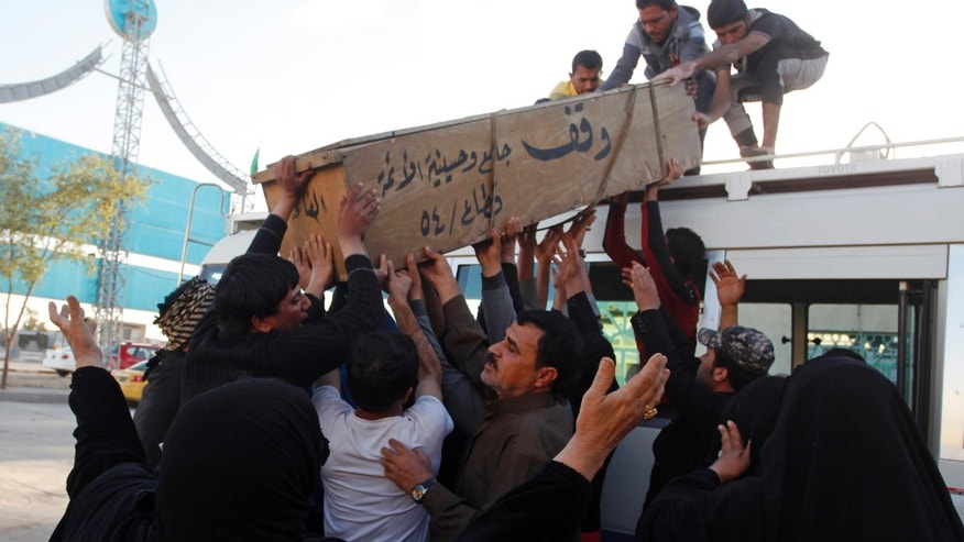 Feb. 17, 2013 - Family members of Hussein Abdullah, 22, killed in a car bomb attack, load his coffin onto a vehicle before transporting the coffin for burial south of Baghdad, Iraq.