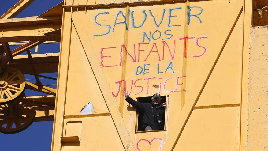 Feb,18, 2013 - French father Serge Charnay, who wants visiting rights with his young son, spending 4th day atop a crane in protest.
