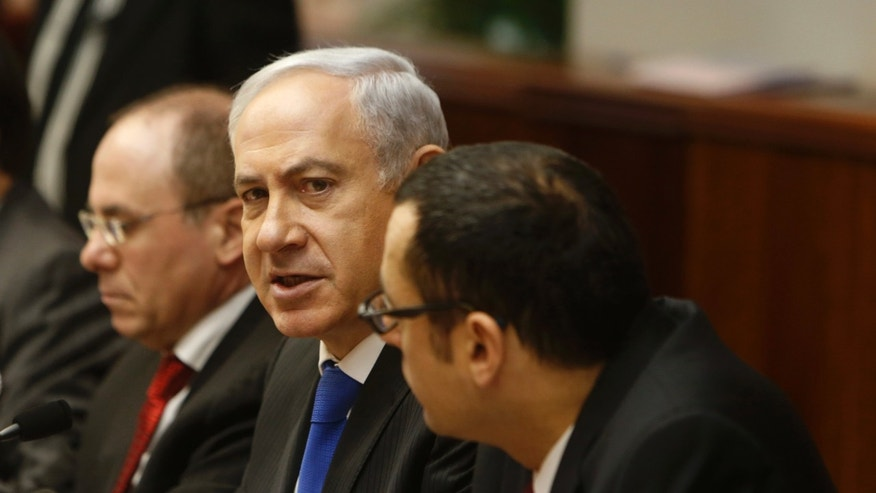 Feb. 17, 2013: Israel's Prime Minister Benjamin Netanyahu, center, heads the weekly cabinet meeting in Jerusalem.