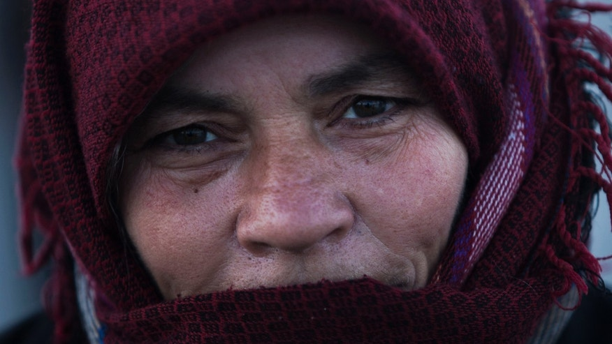 A Syrian refugee woman is seen in a refugee camp near Azaz, north of Aleppo province, Syria, Sunday, Feb. 17, 2013. (AP Photo / Manu Brabo)