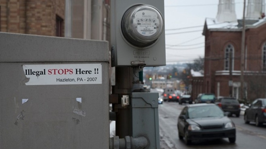 Stickers of the 2006 immigration battle in Hazleton still remain near the town's city hall. (Photo: Andrew O'Reilly)