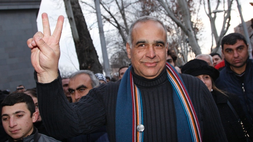 "Presidential candidate Raffi Hovanessian gestures during a meeting with supporters in Yerevan, Armenia, Tuesday, Feb. 19, 2013. American-born Raffi Hovanessian, Armenia's first foreign minister after the 1991 collapse of the Soviet Union, on Tuesday called the election unfair and rigged, claiming cases of ballot-box stuffing and voters being coerced to back Armenia's President Serge Sarkisian. Armenia's president easily won a second term, according to preliminary election results Tuesday, but international observers said the vote ""lacked competition."" (AP Photo/Tigran Mehrabyan, PanARMENIAN)"
