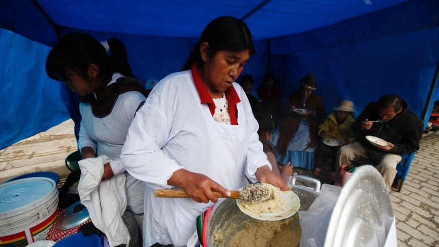 Feb. 17, 2013:  A woman serves pesque, a traditional Andean plate made of cooked quinoa with cheese and milk at a street market in El Alto, Bolivia.