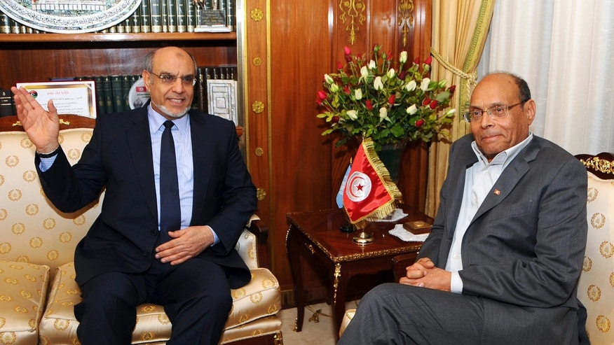 Tunisian President Moncef Marzouki, right, meets Tunisian Prime Minister Hamad Jebali, at the presidential palace of Tunisia, Carthage Palace, Tuesday, Feb. 19, 2013, in Tunis, Tunisia. Tunisia's prime minister announced Tuesday he is resigning following the rejection of his effort to form an apolitical government to see the country out of its political crisis. After the assassination of a leftist politician Feb. 6 deadlocked the government and set off riots across the country, Hamadi Jebali offered to dissolve the fractious governing coalition and put together a new government of technocrats. (AP Photo/Hassene Dridi)
