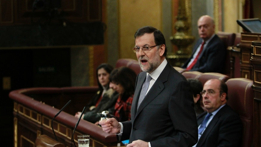 Spain's Prime Minister Mariano Rajoy speaks during state of the nation debate at the Spanish Parliament in Madrid, Spain, Wednesday, Feb. 20, 2013. (AP Photo/Andres Kudacki)