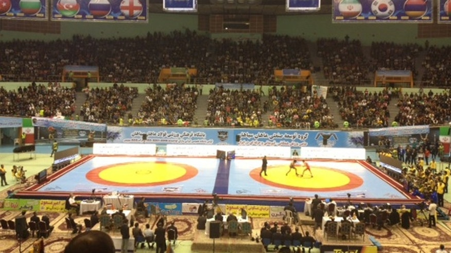 Feb. 21: A sell-out crowd in Tehran's Azadi Sport Complex watches the Freestyle World Cup.