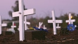 "CALEXICO, CA - FEBRUARY 02:  Grave marker crosses are seen in the night after activists on the ""March for Migrants"" placed them on the graves of approximately 400 people in a cemetery plot set aside for unidentified people who died trying to cross illegally into the US from Mexico on the anniversary of the signing of the treaty of Guadalupe-Hidalgo on February 2, 2006 in Holtville near the border town of Calexico, California. Among a host of issues that the ""March for Migrants"" caravan is pushing are opposition to HR 4437 bill to beef up border operations, demand for action in the case of Guillermo Martinez Rodriguez who was allegedly killed by US Border Patrol agents, and to bring attention to some 4000 migrants who have died since the inception of Operation Gatekeeper in 1994 to increase border patrols, according to the group. The activists will travel throughout much of the West and along the US/Mexico border ending in Washington D.C. with three days of rallies and visits to legislators starting February 18.  (Photo by David McNew/Getty Images)"