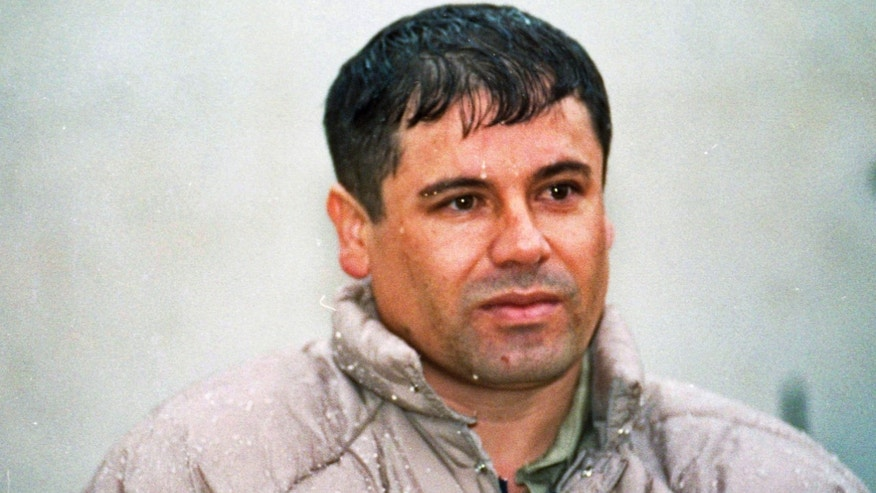 "FILE - In this June 10, 1993 file photo, Joaquin Guzman Loera, alias ""El Chapo"" Guzman, is shown to the media after his arrest at the high security prison of Almoloya de Juarez, on the outskirts of Mexico City. Guatemalan authorities say on Thursday, Feb. 21, 2013, they are investigating whether a man killed in a shootout near the border with Mexico is most-wanted drug lord Joaquin ""El Chapo"" Guzman. (AP Photo/Damian Dovarganes, File)"