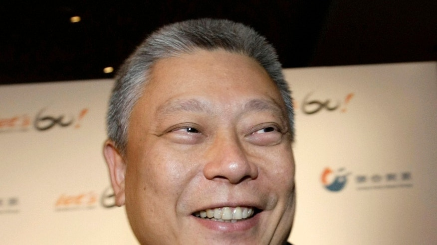 In this Sept. 16, 2011 photo, media mogul Tsai Eng-meng smiles during a public event in Taipei, Taiwan. Appearing last year before Taiwanese regulators, billionaire media magnate Tsai appeared perplexed over a decision to fine his flagship newspaper for carrying camouflaged advertising on behalf of China's Communist government. Tsai, whose pro-China views have made him a lightning rod for criticism on this island of 23 million people, is on the verge of expanding his already substantial Taiwanese media empire through the acquisition of a 32 percent share in Next Media, currently owned by Jimmy Lai, an outspoken anti-communist reviled by Beijing. (AP Photo/Jameson Wu)