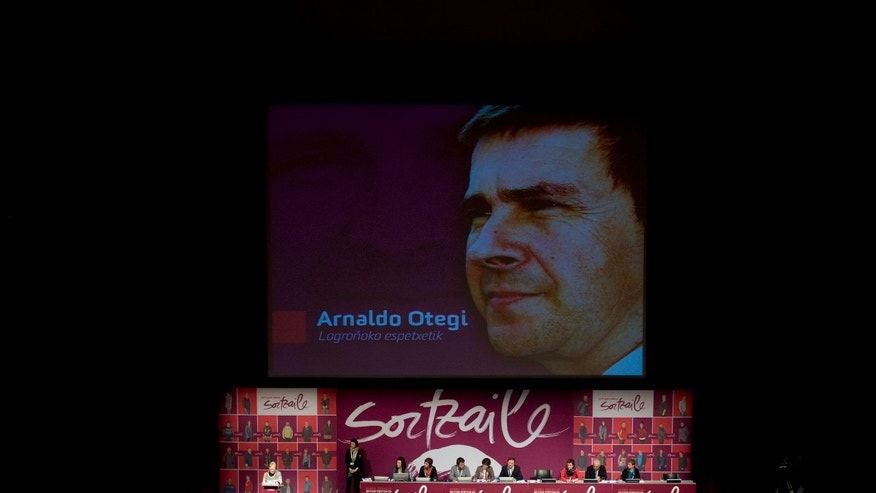 The portrait of Arnaldo Otegi, imprisoned since 2009 for his collaboration with the Basque armed group ETA and honorary leader of the new pro independence Basque party Sortu, is seen on a giant screen during the inaugural congress of Sortu, in Pamplona northern Spain on Saturday, Feb. 23, 2013. Sortu was launched formally Saturday, eight months after the Constitutional Court said Sortu could come into existence because it was different to the outlawed Batasuna.(AP Photo/Alvaro Barrientos)