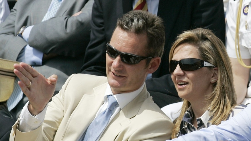 FILE - In this June 11, 2006 file photo, Spanish Princess Christina and her husband Inaki Urdangarin watch the men's tennis final at the French Open tennis tournament in Paris. Urdangarin is accused of having used his position to embezzle several million dollars in public contracts assigned to a nonprofit foundation he set up. The corruption scandal is contributing to the public's diminishing respect for the monarchy. With the 75-year-old king's reputation in decline and several health scares recently, Juan Carlos and the Spanish monarchy are facing one of their biggest crises ever. (AP Photo/Michel Euler, File)