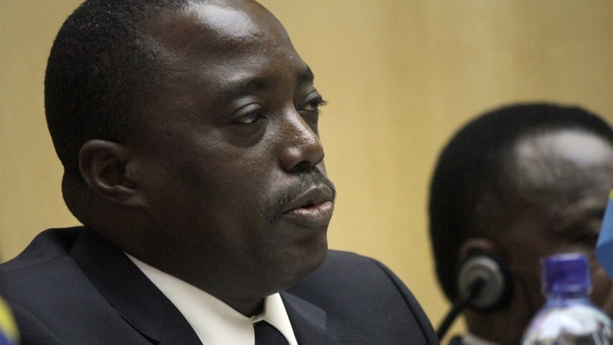 Joseph Kabila , President of the Democratic Republic of Congo, waits for the signing of the Congo peace agreement, in Addis Ababa, Ethiopia, Sunday, Feb. 24, 2013. Eleven African countries have signed a United Nations-drafted peace deal to stabilize the troubled Central African country of Congo, where rebels allegedly backed by neighboring countries last year threatened to oust the government. (AP Photo/ Elias Asmare)