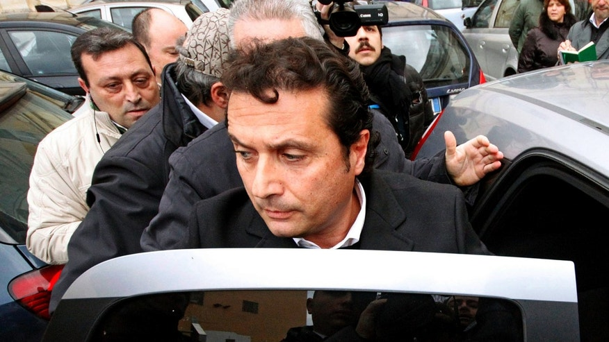 Jan. 30, 2013 - Captian Francesco Schettino gets into a car following a closed-door hearing in Torre Annunziata's courthouse, near Naples, Italy.