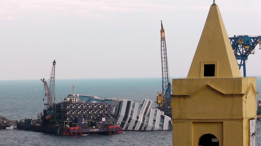 Jan. 11, 2013 FILE photo shows the cruise ship Costa Concordia leaning on its side, near the shore of the Tuscan island of Giglio, Italy.
