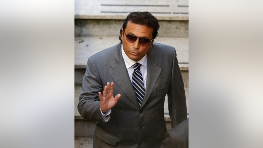 FILE photo shows former captain of the Costa Concordia luxury cruise ship Francesco Schettino arriving at the Teatro Moderno theater for the second hearing of a trial for the Jan. 13, 2012 shipwreck in which 32 people died, in Grosseto, Italy. An Italian prosecutor on Monday, Feb. 25, 2013 formally requested a manslaughter indictment against the captain of the Costa Concordia, which crashed into a reef off Tuscany last year, killing 32 people. The prosecutors' office in Grosseto, Tuscany, also wants Francesco Schettino, the captain of the luxury cruise liner, to be tried for causing a shipwreck and abandoning ship while the frantic evacuation of passengers and crew was still being conducted. (AP Photo/Gregorio Borgia, files)