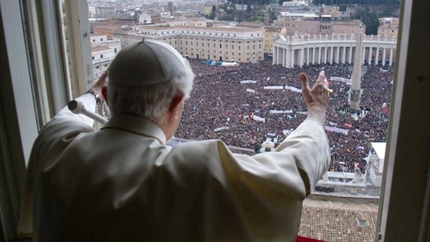 Pope Benedict XVI delivers his blessing during his last Angelus noon prayer, from the window of his studio overlooking St. Peter's Square, at the Vatican, Sunday, Feb. 24, 2013.