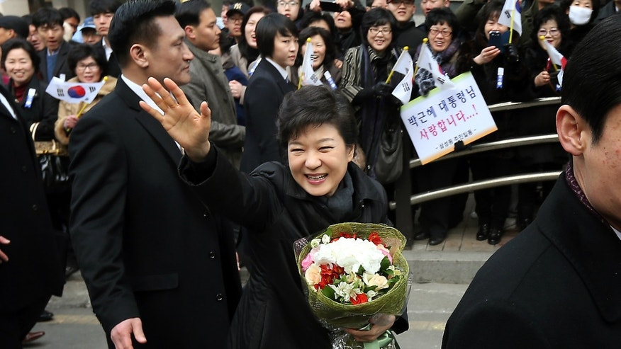 South Korea's new President Park Geun-hye waves to supporters while leaving her private residence for her inauguration ceremony at the National Assembly in Seoul, South Korea, Monday, Feb. 25, 2013. Park has become South Korea's first female president and returned to the presidential mansion where she grew up with her dictator father.  (AP Photo/Yonhap, Shin Jun-hee) KOREA OUT