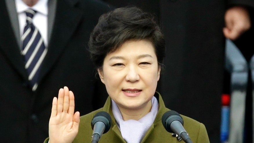 South Korea's new President Park Geun-hye takes an oath during her inauguration ceremony at the National Assembly in Seoul, South Korea, Monday, Feb. 25, 2013. Park became South Korea's first female president Monday, returning to the presidential mansion where she grew up with her dictator father.  (AP Photo/Lee Jin-man)