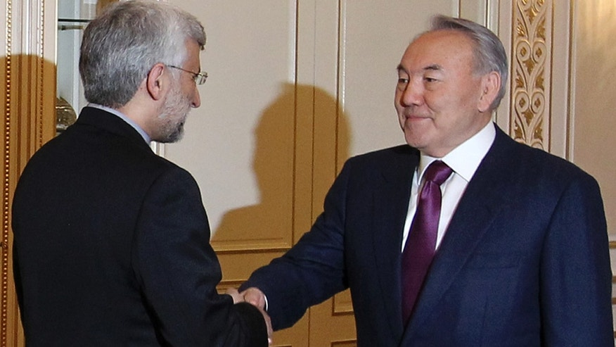 Feb. 25, 2013: Chief Iranian nuclear negotiator Saeed Jalili, left, shakes hands with Kazakhstan's President Nursultan Nazarbayev prior their talks in Almaty, Kazakhstan.  Iran and six world powers, five permanent U.N. Security council members and Germany, are set to hold talks in Kazakhstan this week on Tehran's controversial nuclear program.