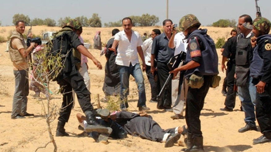 Egyptian security forces arrest militants after a firefight in Egypt's north Sinai region last year. Weapons once used in Libya are finding their way into the region, say Israel Defense Force sources. (Reuters)