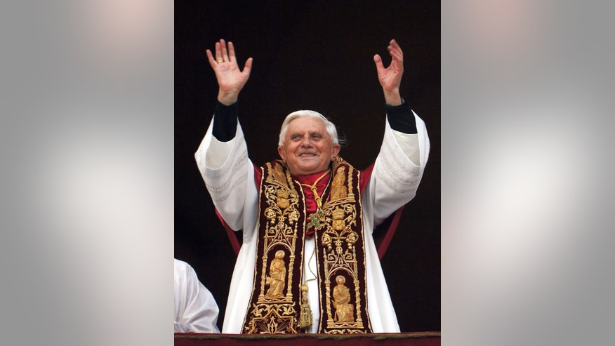 FILE - Pope Benedict XVI greets the crowd from the central balcony of St. Peter's Basilica at the Vatican, in this April 19, 2005, file photo. Joseph Ratzinger of Germany, who chose the name of Pope Benedict XVI,  became the 265th pontiff of the Roman Catholic Church. (AP Photo/Domenico Stinellis/file)