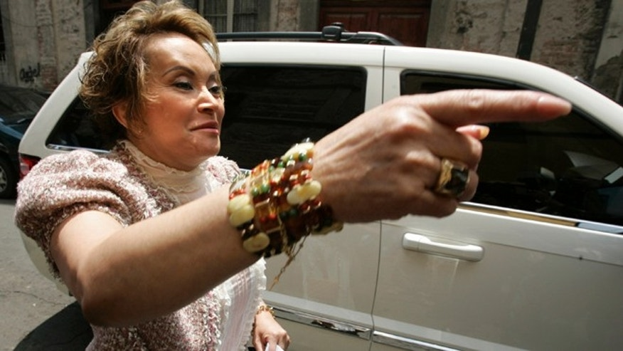 Mexican union head Elba Esther Gordillo gestures as she arrives to attend a meeting with education workers on July 14, 2006.