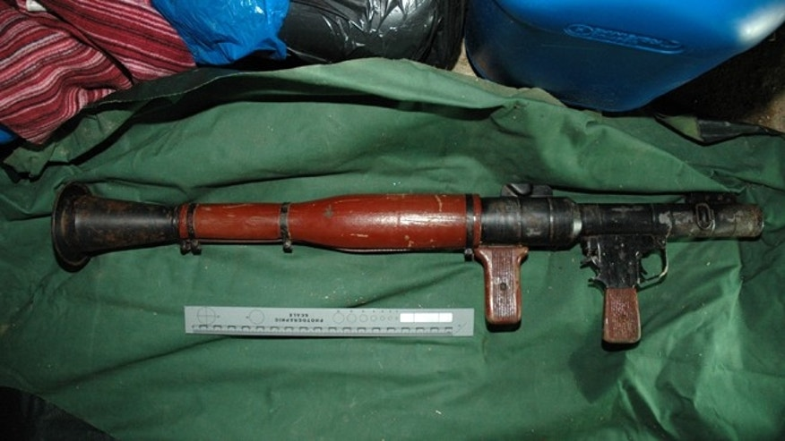 This is image of an image of a rocket propelled grenade launcher that was recovered during  a raid in Belfast on Monday Feb. 25, 2013 and made available by the Police Service of Northern Ireland,  Wednesday Feb. 27, 2013.