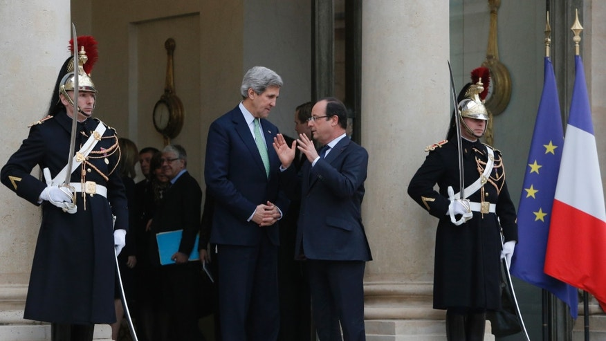 U.S. Secretary of State John Kerry, left, is accompanied by France's President Francois Hollande after their meeting at the Elysee Palace, in Paris, Wednesday, Feb. 27, 2013. Paris is the third leg of Kerry's first official overseas trip, a hectic nine-day dash through Europe and the Middle East. (AP Photo/Francois Mori)