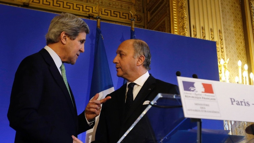 U.S. Secretary of State John Kerry, left, shakes hands after a news conference with French Minister of Foreign Affairs Laurent Fabius at the Foreign Ministry in Paris on Wednesday, Feb. 27, 2013. Paris is the third leg of Kerry's first official overseas trip, a hectic nine-day dash through Europe and the Middle East. (AP Photo/Jacquelyn Martin, Pool)