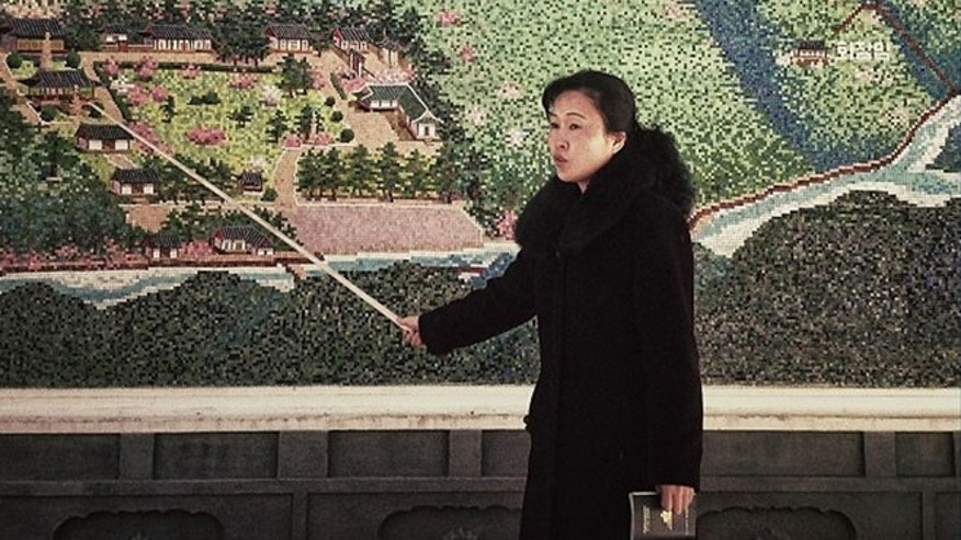 Feb. 24, 2013: In this photo posted to Instagram , a North Korean guide uses a pointer at the start of a tour of an historic site in Pyongyang.