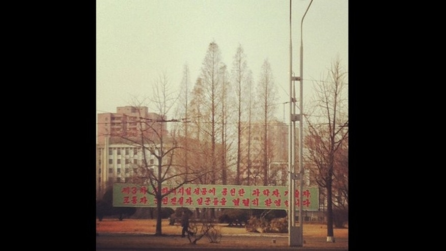 In this photo posted on Instagram, a man walks in Pyongyang, North Korea, under a new roadside banner referring to North Korea&#39&#x3b;s controversial Feb. 12 nuclear test Monday, Feb. 25, 2013. Tweeting and uploading to Instagram is pretty ordinary stuff in the world of social media, but revolutionary for North Korea.