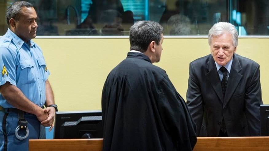 Feb. 28, 2013: Gen. Momcilo Perisic, the former chief of staff of the Yugoslav national army, right, talks to his lawyer prior to his appeal judgment in the court room of the Yugoslav war crimes tribunal in The Hague, Netherlands.