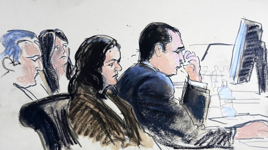 In this courthouse sketch, Gilbert Valle, reacts during his trial in federal court Monday, Feb. 25, 2013, in New York.