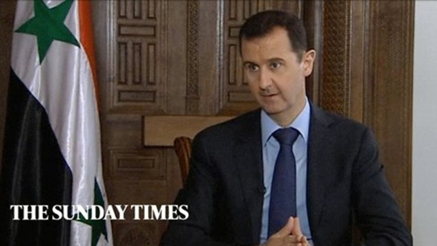 Feb. 28, 2013: Syrian President Bashar Assad speaks during an interview with the Sunday Times, in Damascus, Syria.