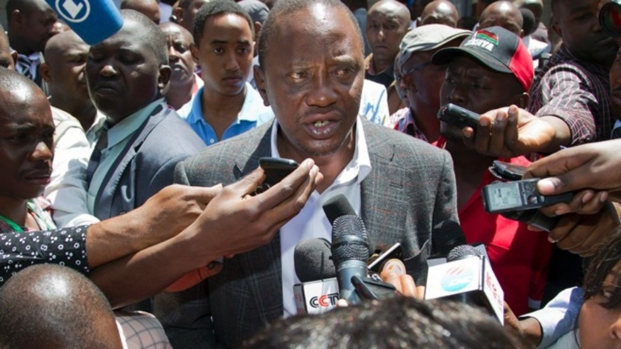 March 4, 2013: Kenyan Presidential candidate Uhuru Kenyatta speaks to the media after casting his vote, at the Mutomo primary school near Gatundu, north of Nairobi, in Kenya.