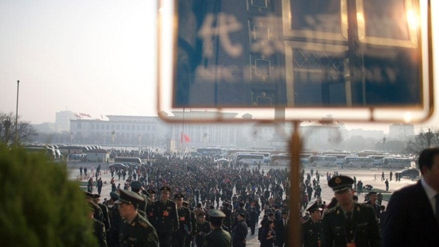 March 5, 2013: Delegates from the Chinese People's Liberation Army walk up steps to attend the opening session of the annual National People's Congress held at Beijing's Great Hall of the People, in China.