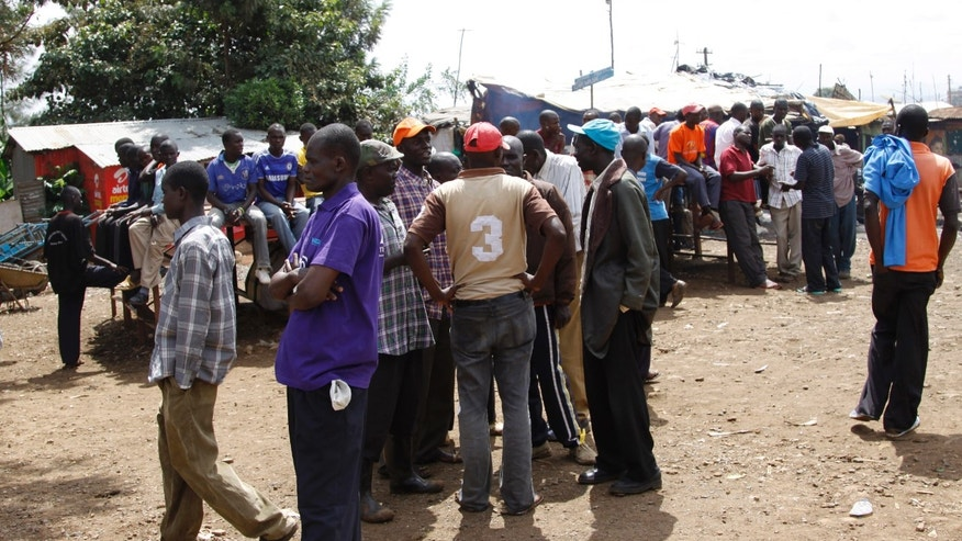March 8, 2013 - Supporters of Raila Odinga wait in groups in Kibera Slums, Nairobi, Kenya as the result of the Kenya election was expected to be announced.
