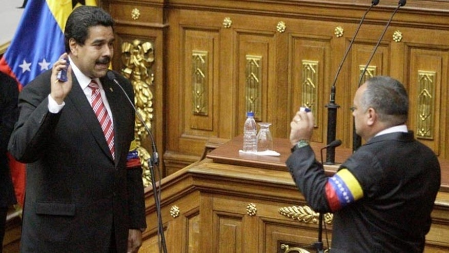 March 8, 2013: Nicolas Maduro takes the presidential oath from  National Assembly's President Disodado Cabello during a swearing-in ceremony at the National Assembly in Caracas, Venezuela.