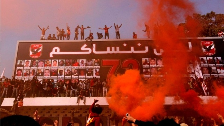 March 9, 2013: Egyptian soccer fans of Al-Ahly club celebrate in front of their club in Cairo, Egypt, after an Egyptian court confirmed death sentences against 21 people for their role in a deadly 2012 soccer riot.